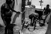 People washing in a cemetery.<br>Port-au-Prince, Haiti - May 7, 2015.